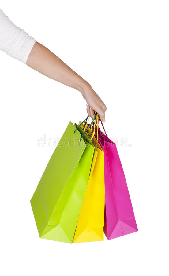 Female Hand Holding Colorful Shopping Bags Royalty Free Stock Images