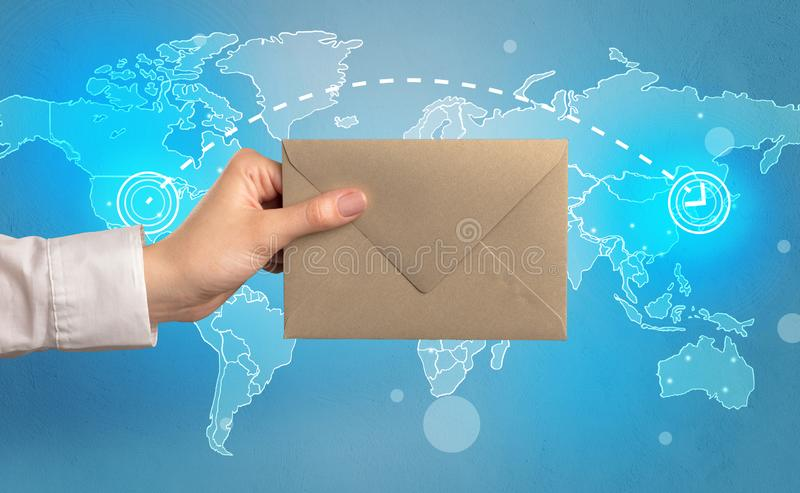 Hand holding envelope with global concept stock illustration