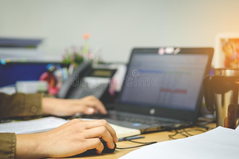 Female hand holding computer mouse for office work, Business con stock photography