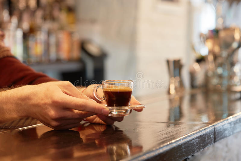 Female hand holding cup of coffee royalty free stock photos