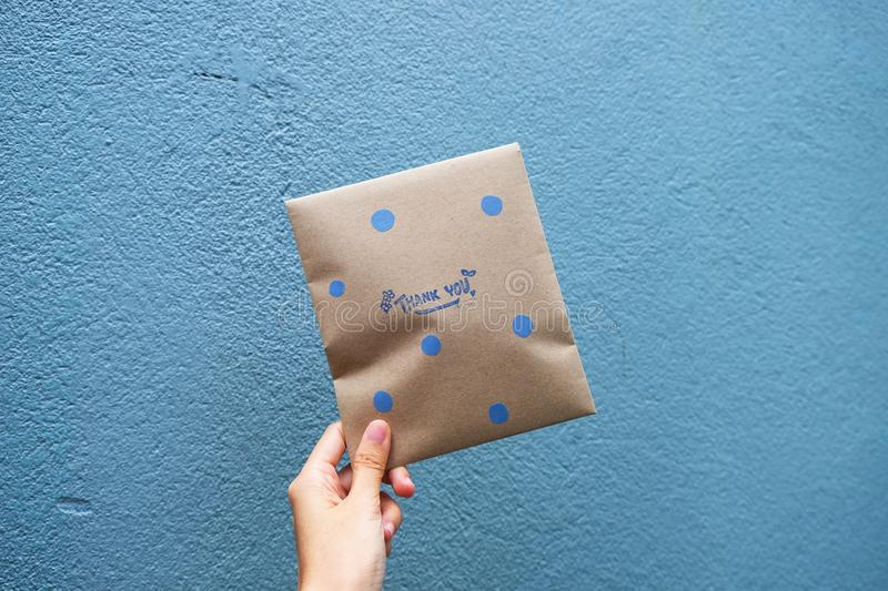 Female hand holding a envelope gift stock photography