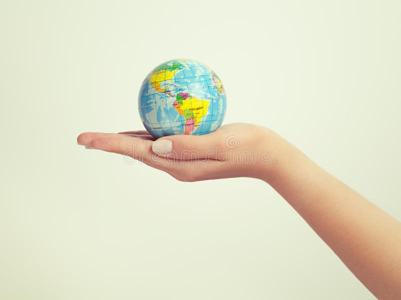 Female hand holding globe. save the earth and success concept stock photos