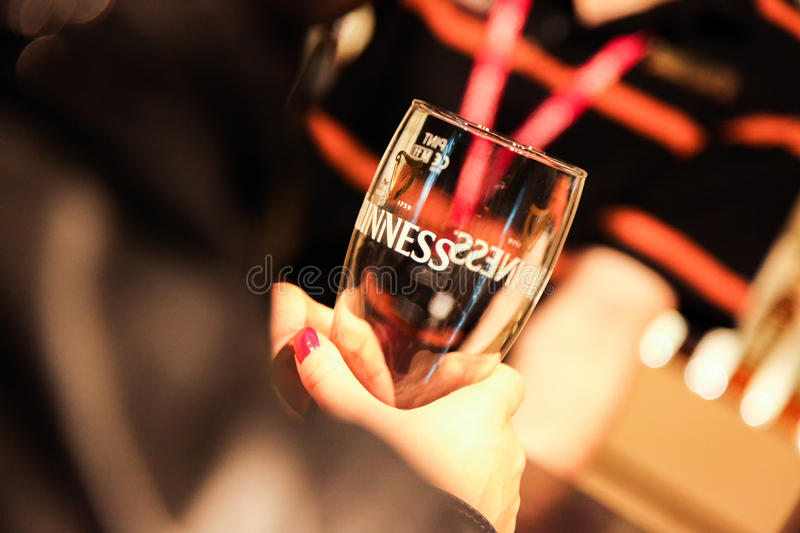 Female hand holding guinness glass at Guiness Storehouse Brewery, Dublin stock images
