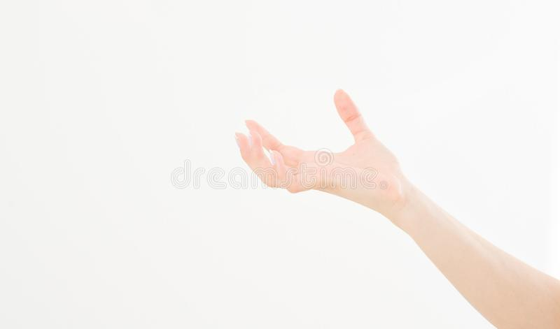 Female hand holding invisible items, woman`s palm making gesture while showing small amount of something on white isolated. Background, side view, close-up stock photography