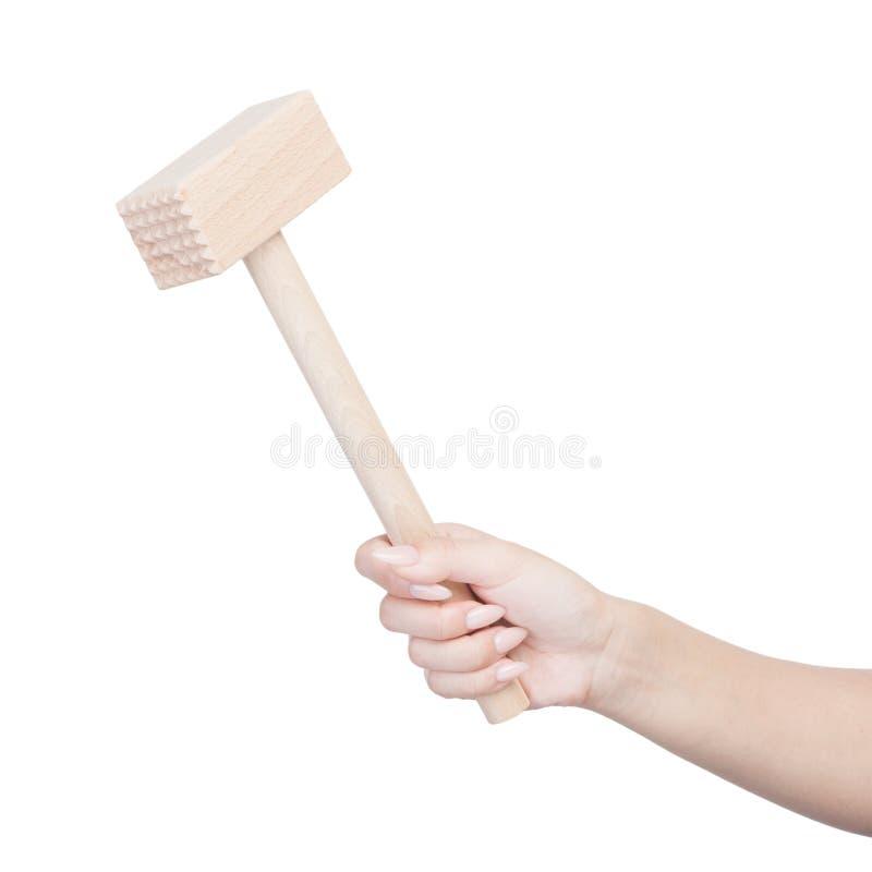 Female hand holding kitchen hammer. Isolated on white stock photos