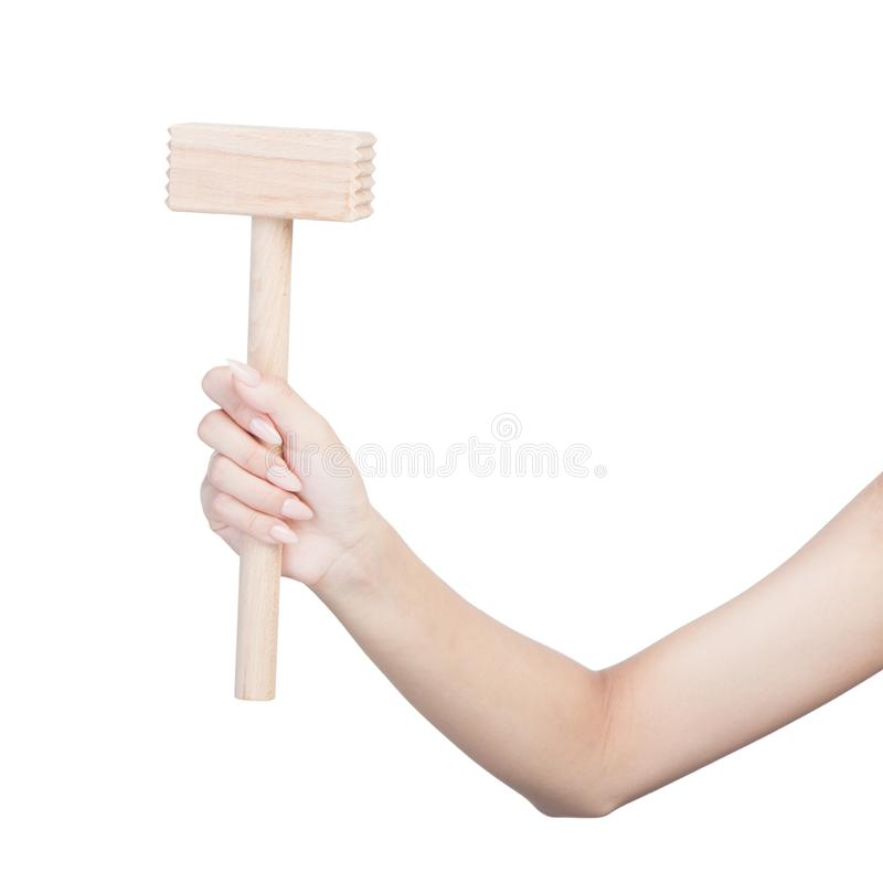 Female hand holding kitchen hammer. Isolated on white royalty free stock photos