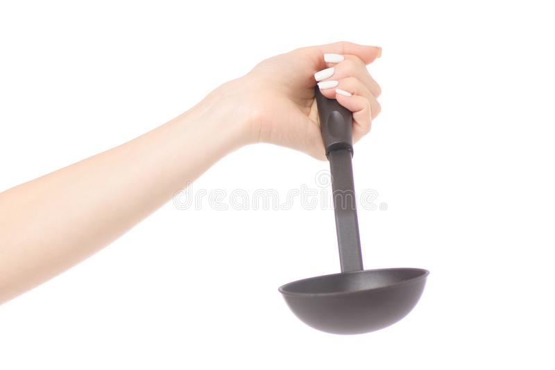 Female hand holding kitchen scoop royalty free stock photo
