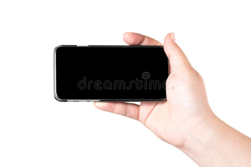 Female hand holding mobile smart phone isolated on white background. Concept of selfie making photo.  stock image