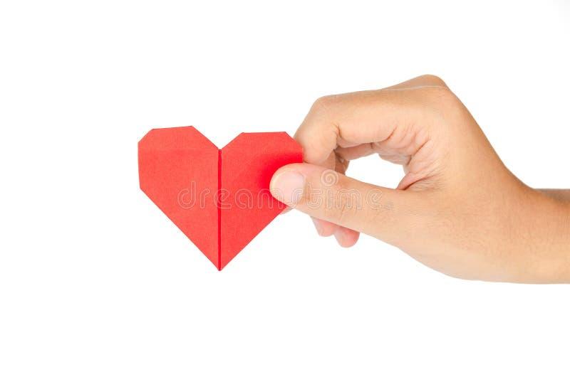 Female hand holding paper heart stock image