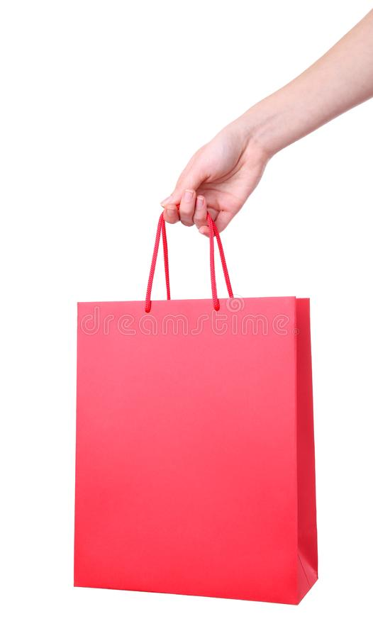 Female hand holding red shopping bag, isolated on white royalty free stock photo