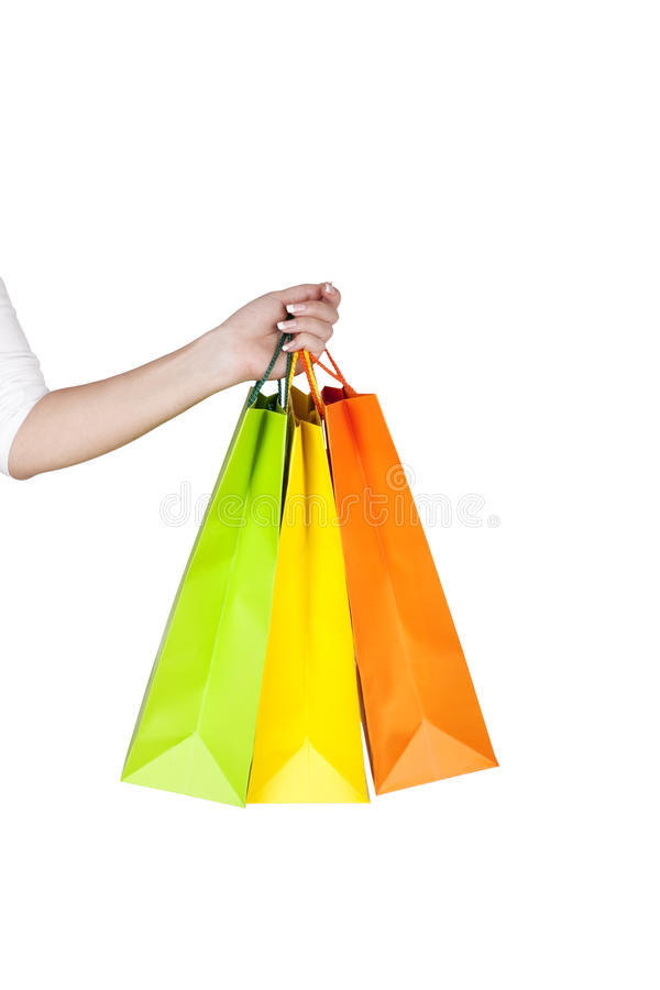 Female hand holding  shopping bags