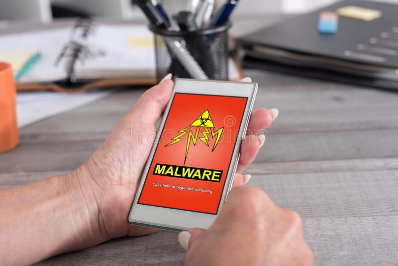 Malware concept on a smartphone royalty free stock photo