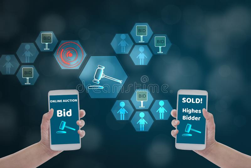 Female hand holding smartphone to Enter the price for bid,via wireless network on blue bokeh background with auction icon, Concept royalty free stock images