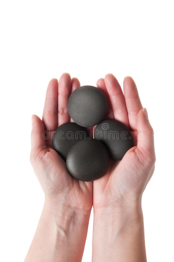Download Female Hand Holding Spa Stones Stock Image - Image of bathroom, purity: 18039023