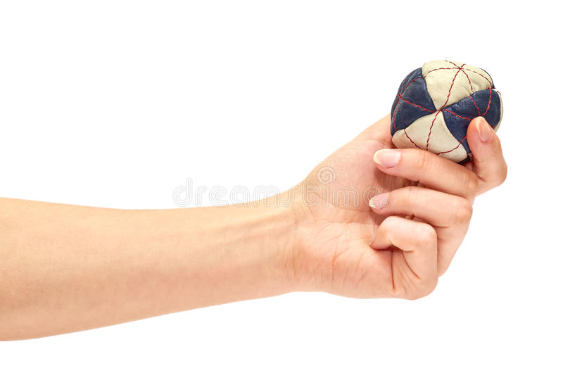 Female hand holding a special ball hackysack for sport in the company of friends. royalty free stock photos