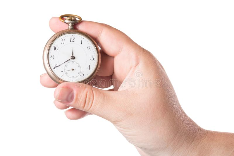 Female hand holding vintage clock isolated on a white background royalty free stock photos