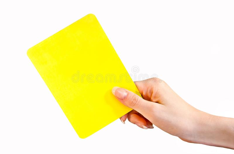 Female hand holding yellow card royalty free stock photo