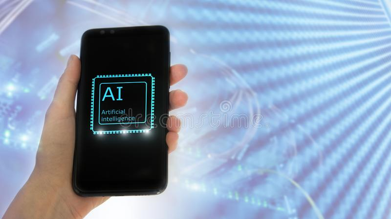 Female hand holds the phone, on the screen the inscription: artificial intelligence. icon hologram 3D on server room background stock photography
