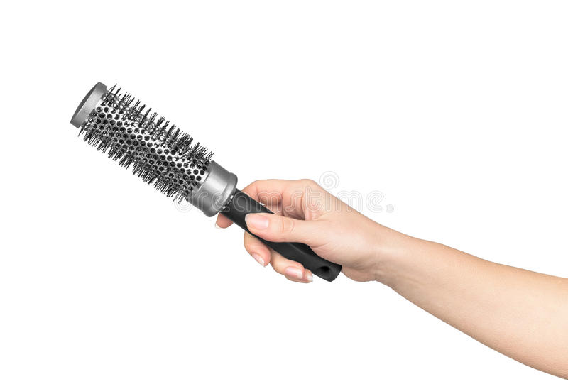Female hand holds a professional hair brush royalty free stock photos