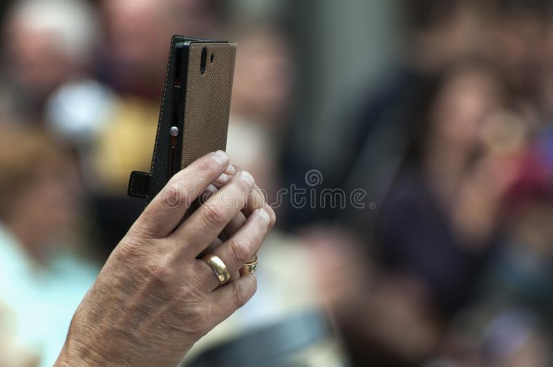 A female hand holds a smart phone stock photo