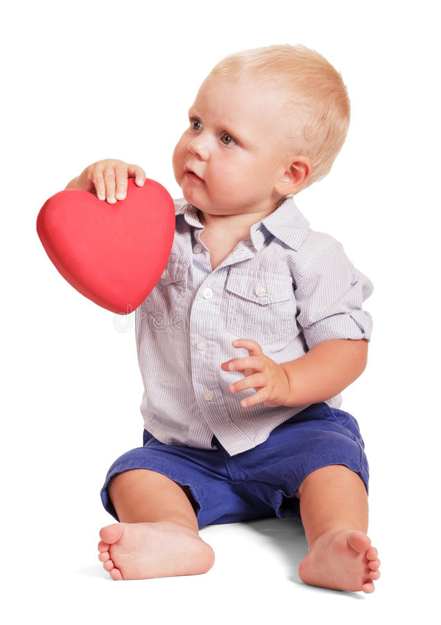 Female and hand little boy sitting holding red heart isolated. Female hand and the hand of a little boy sitting holding red heart isolated on white background stock image