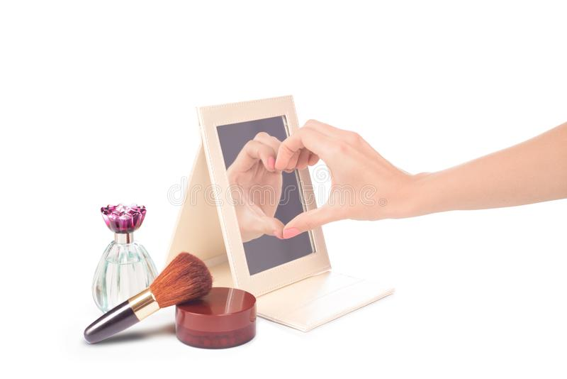 Female hand with love gesture in which one side reflected in the stock image