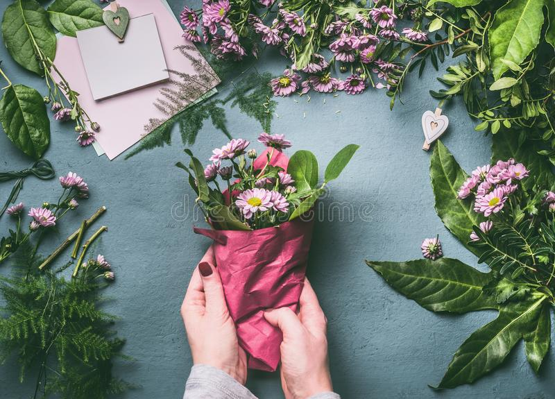 Female Hand Making Beautiful Bouquet Of Pink Flowers On Florist ...