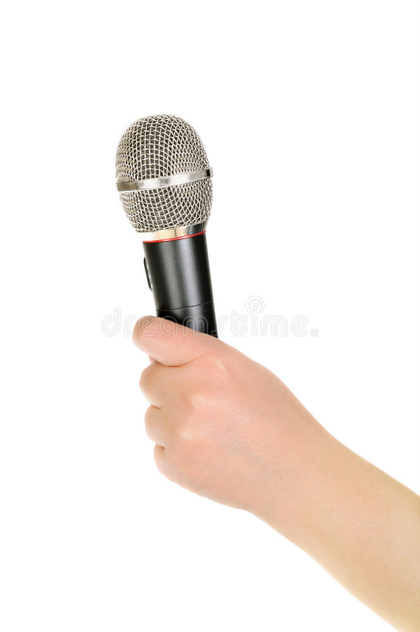 Female hand with a microphone royalty free stock photography