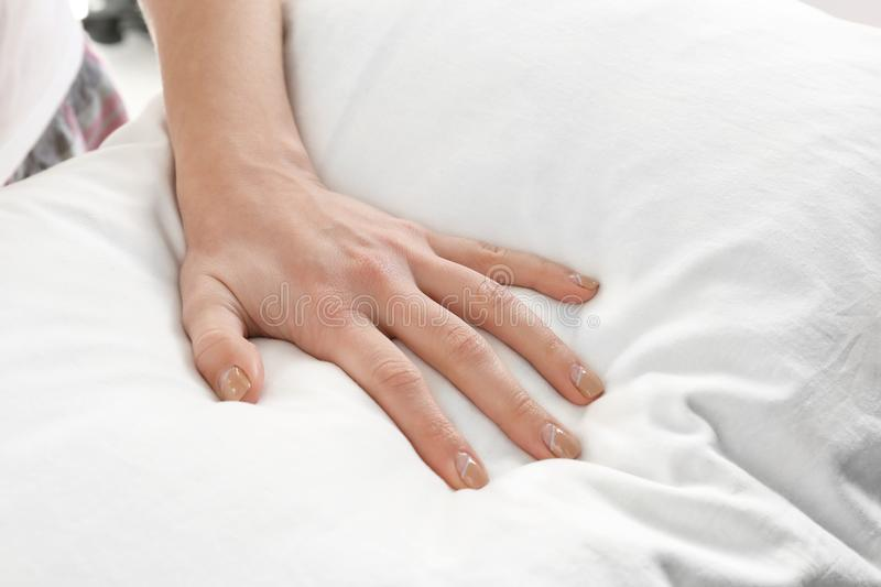Female hand on orthopedic pillow. Closeup stock images