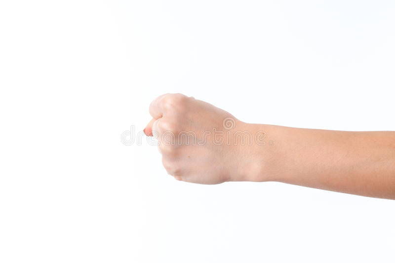 Female hand outstretched to the side and showing a fist is isolated on white background. Female hand outstretched to the side and showing a fist is isolated on a stock images