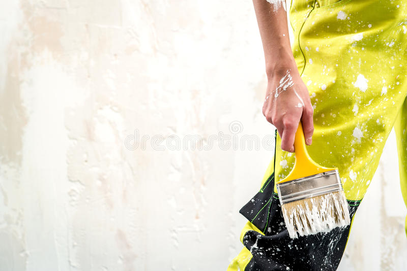 Female hand with paint brush royalty free stock image