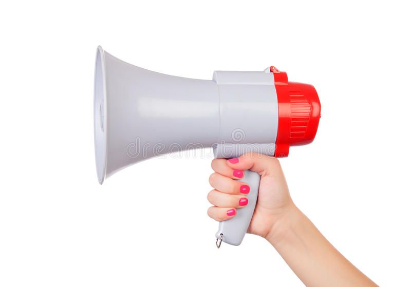 Female hand with pink nails holding a megaphone. Isolated on a white background stock image