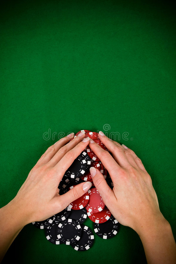 Female hand and poker chips royalty free stock images