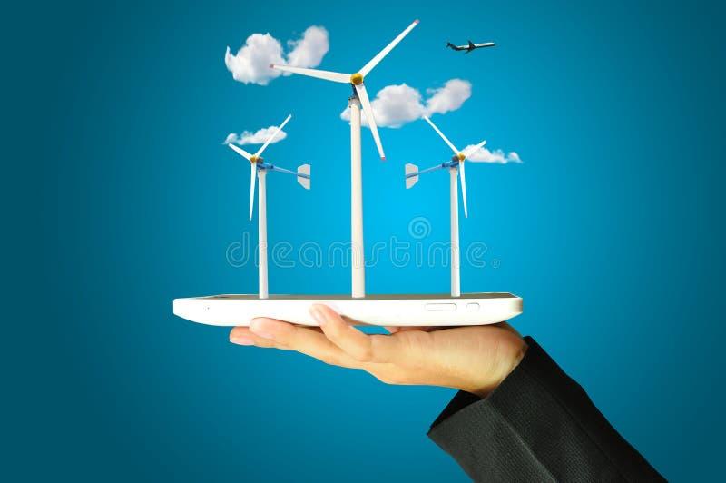 Female hand present wind turbine power generator royalty free stock images