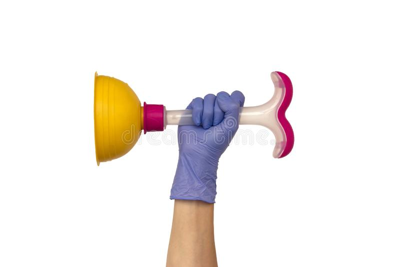 Female hand in a purple rubber glove holds a yellow plunger with. A pink plastic handle. Isolate on white background. The concept of a housewife royalty free stock photography