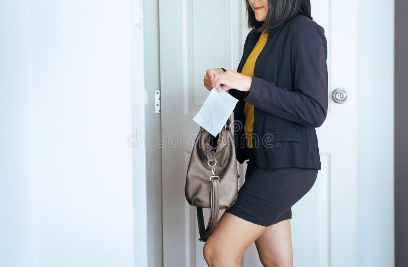 Female hand putting sanitary napkins out of handbag,White menstrual pad. Female hands putting sanitary napkins out of handbag,White menstrual pad stock image