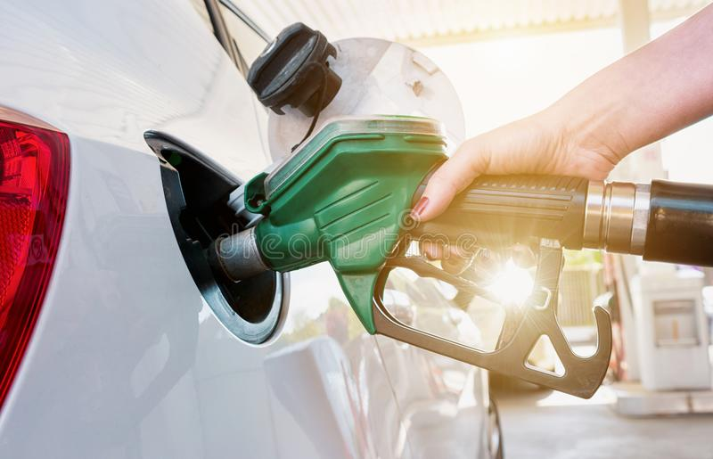 Female hand refilling the car with fuel on a filling station royalty free stock photography