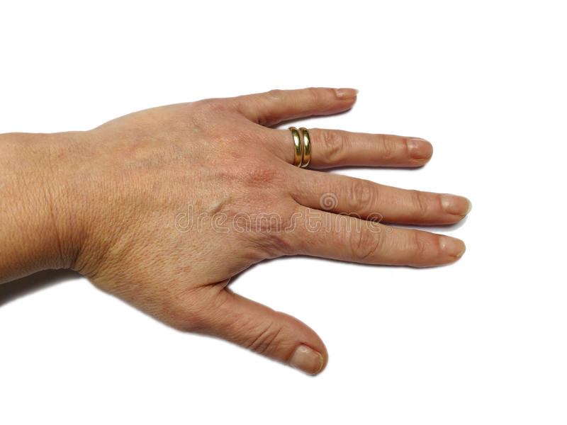 Female hand in rest position, double gold wedding ring isolated stock images