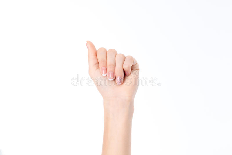 Female hand showing the gesture with bent down your fingers is isolated on a white background. Hand showing the gesture with bent down with your fingers is royalty free stock photography