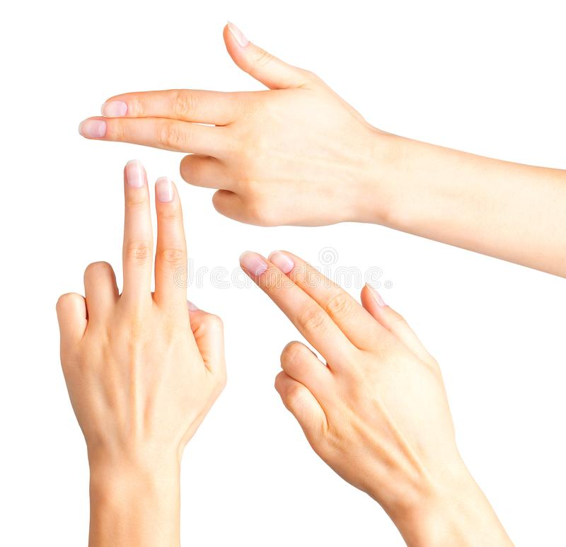 Female hand showing two fingers in the peace symbol. Female hand showing two fingers up in the peace, swear sign or multitouch gesture. Isolated with clipping stock images
