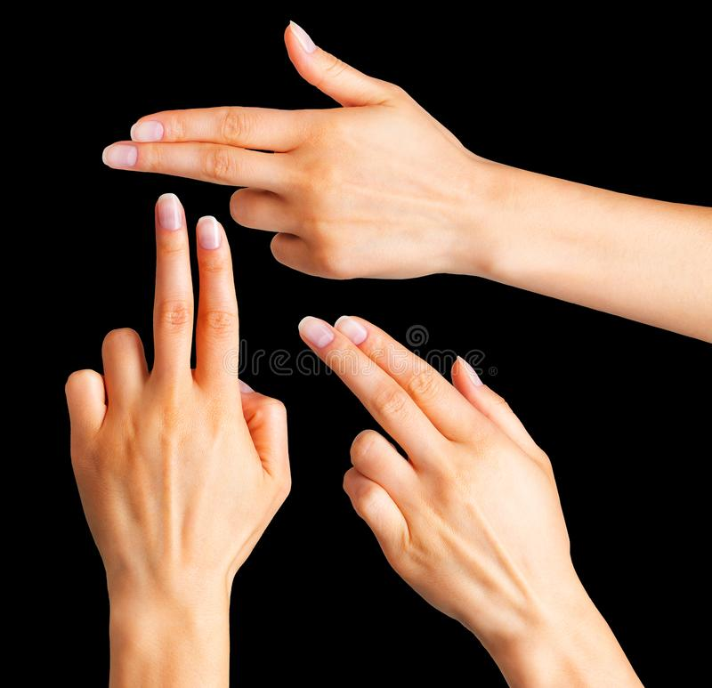 Female hand showing two fingers in the peace symbol. Female hand showing two fingers up in the peace, swear sign or multitouch gesture. Isolated with clipping royalty free stock photo