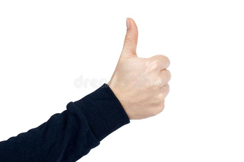 Female hand shows thumb up gesture and sign. Isolated on white background. Dark blue pullover stock photo