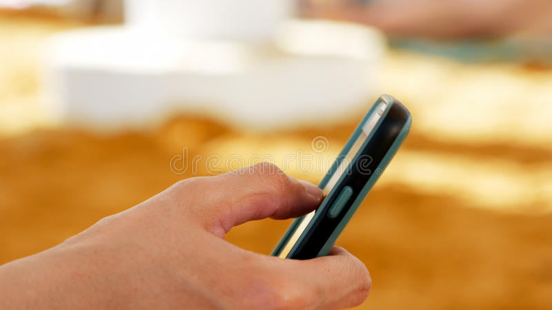 Female hand with smartphone closeup royalty free stock images