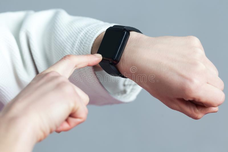 Female hand with smartwatch are toching with finger and checking stock photo