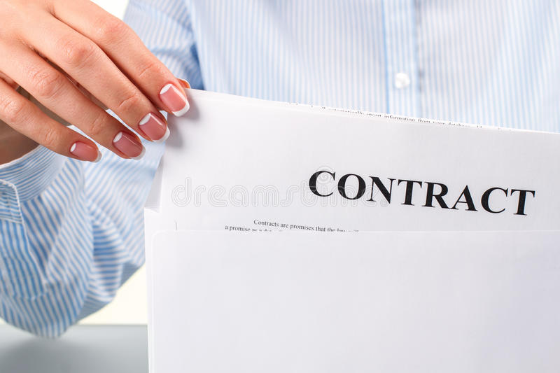 Female hand takes contract letter. Woman's hand taking contract letter. Female hand takes contract letter. Definitely good news. I have good chances stock images