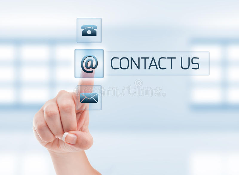 Female hand touching contact us button royalty free stock photography