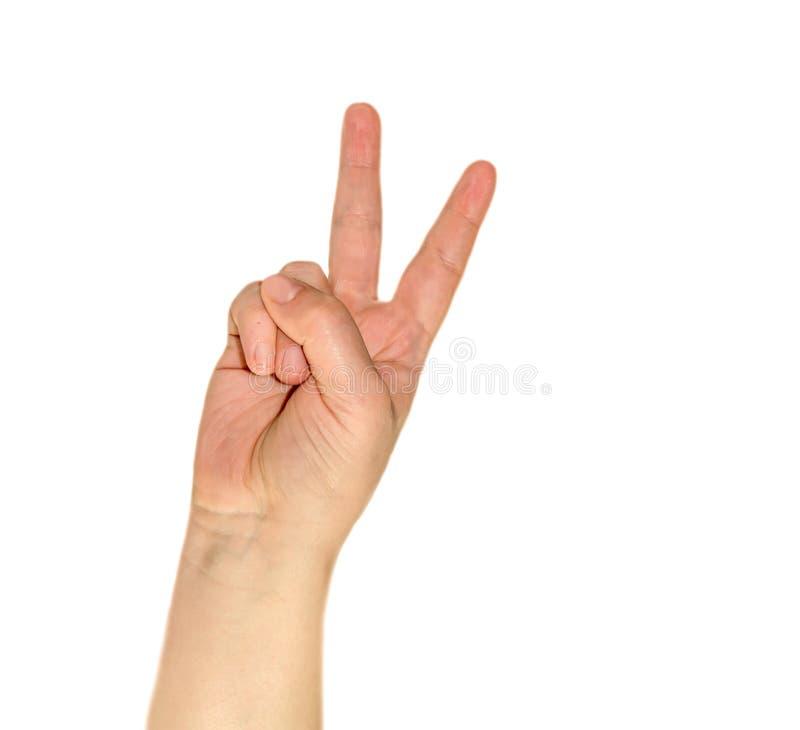 Hand gesturing peace symbol stock photos