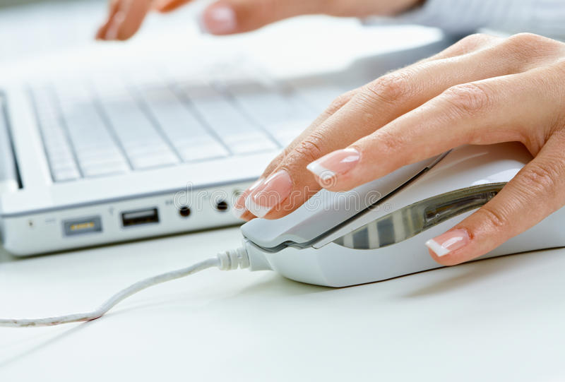 Female hand using computer mouse royalty free stock photo
