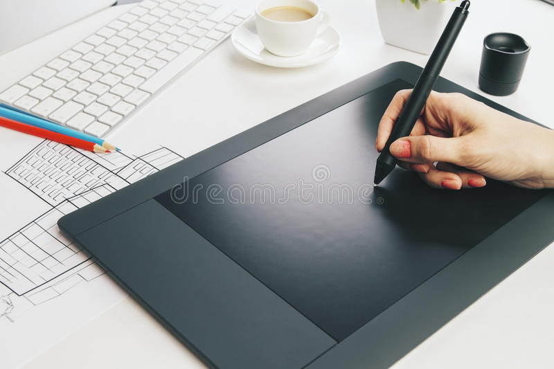 Female hand using graphic tablet stock photography