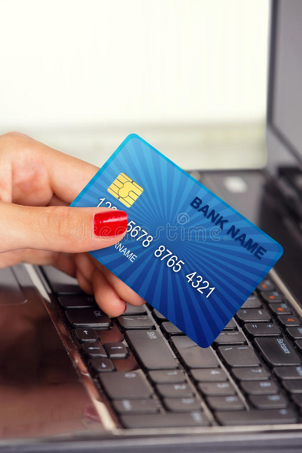 Female hand,using internet card for e-banking. stock images